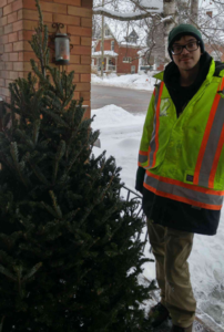 Adult children article bringing in the Christmas tree