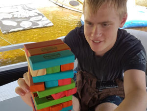 Teen playing Jenga